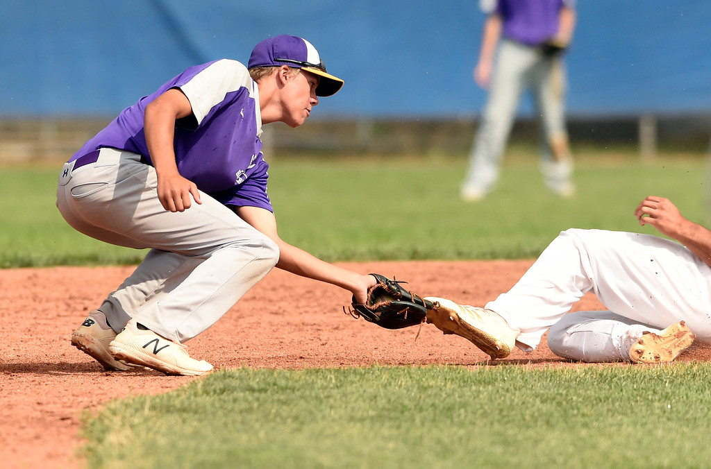 . Holy Family\'s Josh Baker tags out Isaiah Salazaar at second base during a Legion game against Windsor on Friday at Centaurus High School in Lafayette. More photos: BoCoPreps.com Jeremy Papasso/ Staff Photographer 07/27/2018