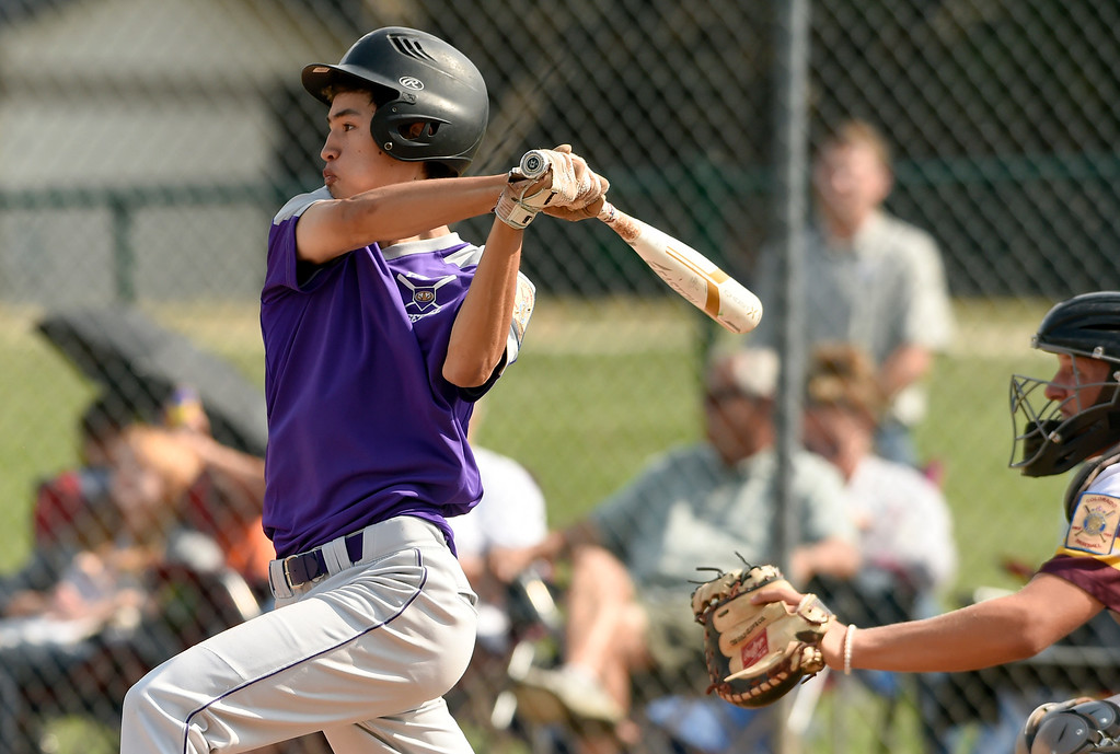 . Holy Family\'s Zach Becker gets a base hit during a Legion game against Windsor on Friday at Centaurus High School in Lafayette. More photos: BoCoPreps.com Jeremy Papasso/ Staff Photographer 07/27/2018