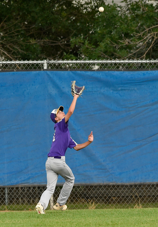 . Holy Family\'s Connor Cooney makes a catch in center field during a Legion game against Windsor on Friday at Centaurus High School in Lafayette. More photos: BoCoPreps.com Jeremy Papasso/ Staff Photographer 07/27/2018
