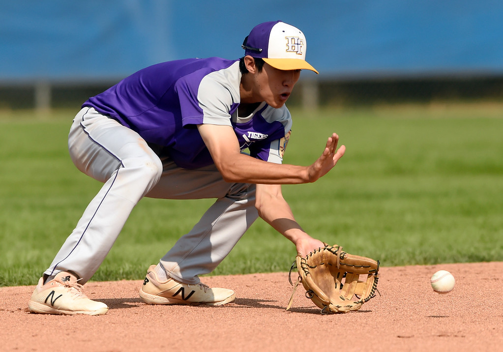 . Holy Family\'s Zach Becker makes a stop at short-stop for an out at first base during a Legion game against Windsor on Friday at Centaurus High School in Lafayette. More photos: BoCoPreps.com Jeremy Papasso/ Staff Photographer 07/27/2018