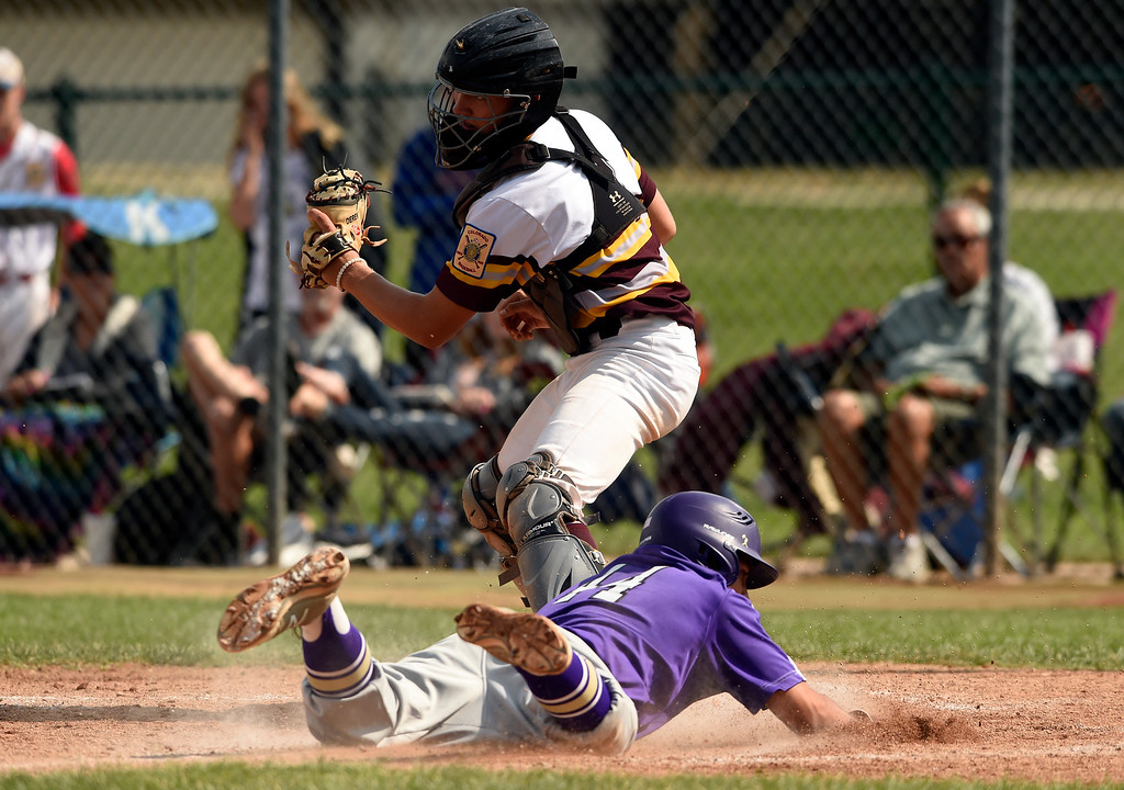 . Holy Family\'s Matthew Delgado slides into home safely under the tag of Derek Baessler during a Legion game against Windsor on Friday at Centaurus High School in Lafayette. More photos: BoCoPreps.com Jeremy Papasso/ Staff Photographer 07/27/2018