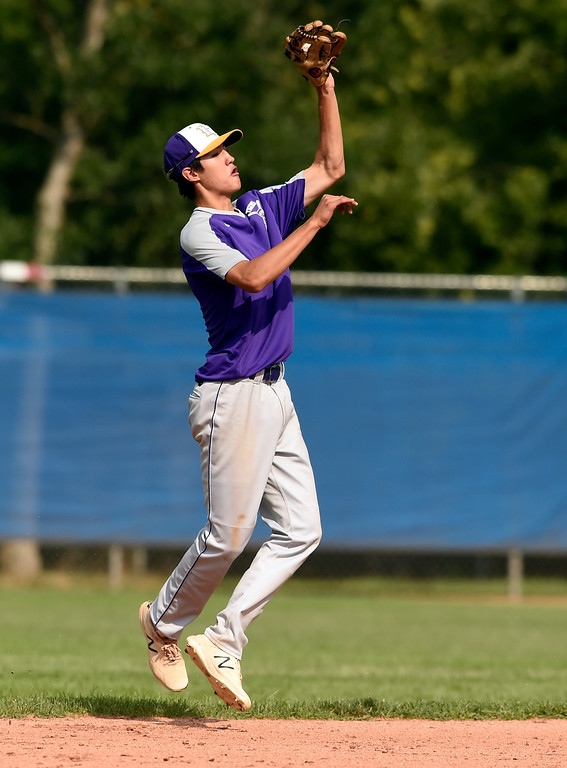 . Holy Family\'s Zach Becker makes a leaping catch during a Legion game against Windsor on Friday at Centaurus High School in Lafayette. More photos: BoCoPreps.com Jeremy Papasso/ Staff Photographer 07/27/2018