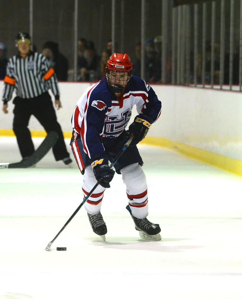 Jarod Crespo (4) brings puck up ice for Ghost.