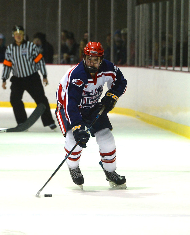 . Jarod Crespo (4) brings puck up ice for Ghost.