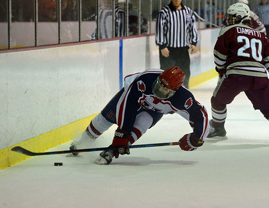 Luke Aquaro (68) shows great balance in controlling puck.