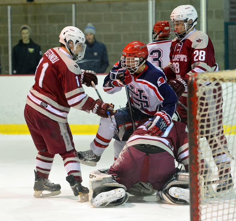 . Players battle in front of Saint Joseph goal.