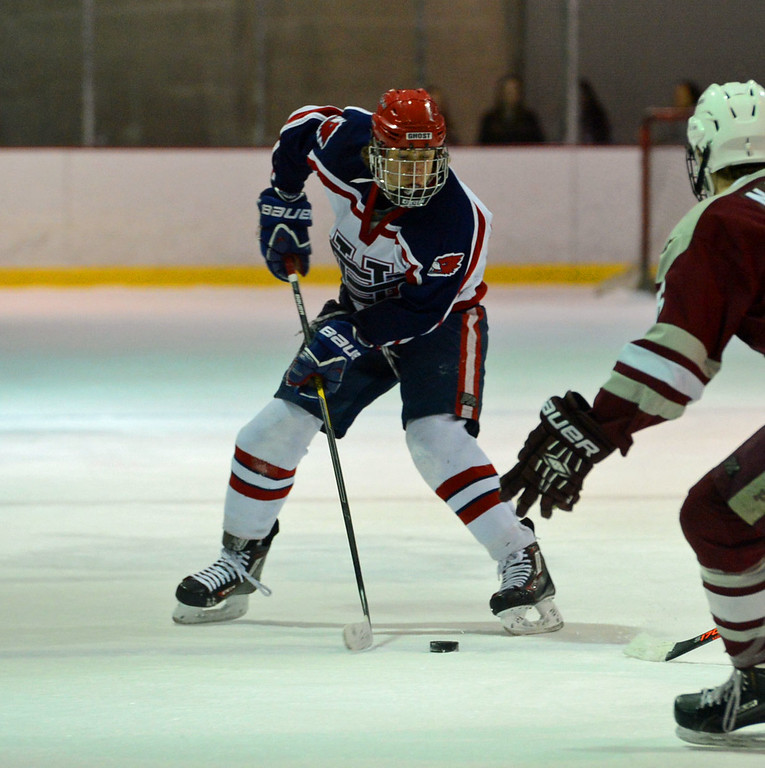 . Tim Wolfe (78) controls puck at mid-ice.