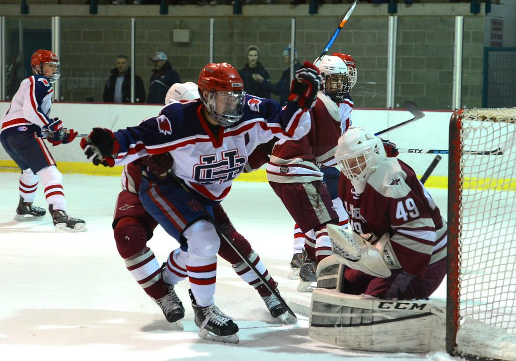 . Holy Ghost Prep\'s Luke Aquaro (68) pressures Saint Joseph\'s Prep goaltender Gianni D\'Angelo (72) in the Flyers Cup Semifinals held March 16, 2017 at Hatfield Ice. (John Gleeson � 21st-Century Media)