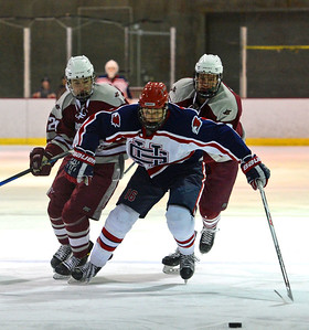 Jack Smiley (16) beats St Joe defenders to the puck.