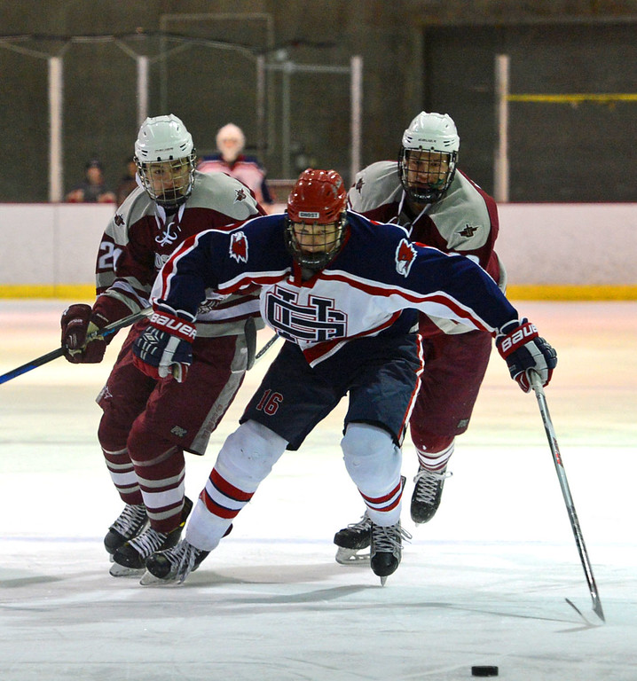 . Jack Smiley (16) beats St Joe defenders to the puck.