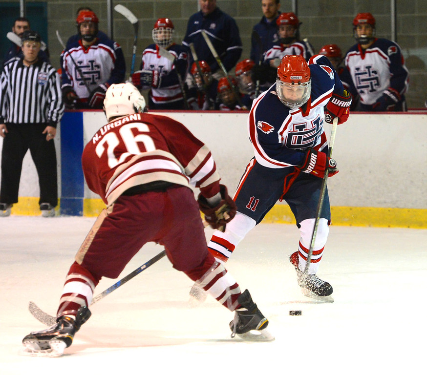 . Luke Ledes (11) maneuvers puck around Nick Urbani (26).