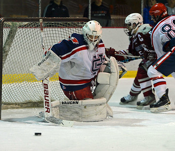 Goalie Tristan Devine (30) gets set to pounce on the puck.