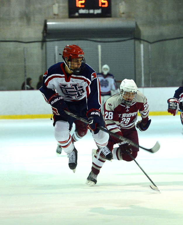 . Holy Ghost Prep\'s Andrew Serafin (3) and St. Joseph\'s Prep\'s Nate Urbani (28) fly to the puck in the Flyers Cup Semifinals held March 16, 2017 at Hatfield Ice. (John Gleeson � 21st-Century Media)