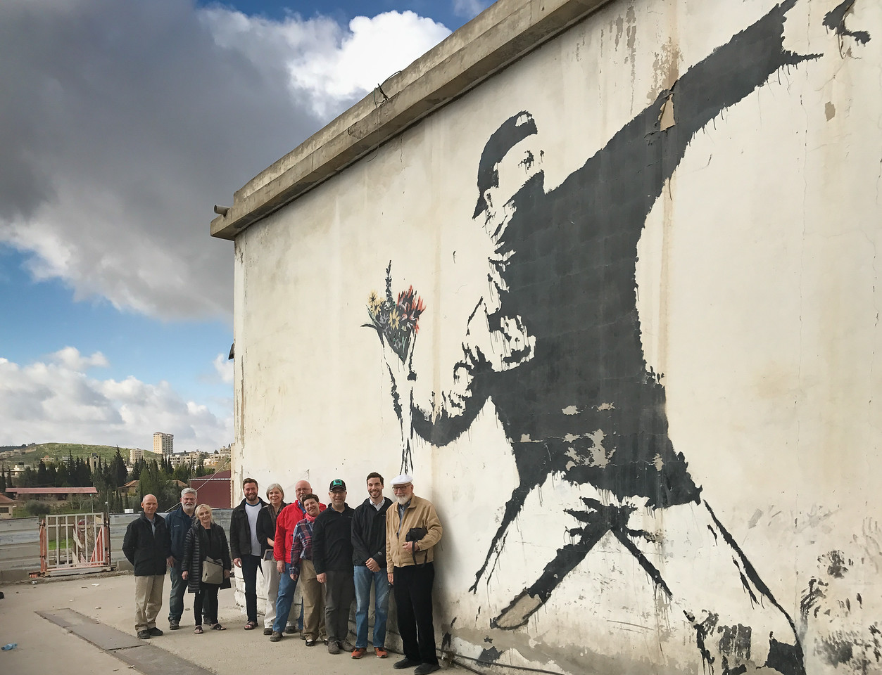 Separation wall with Banksy graffiti. and our tour group