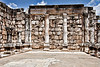 Capernaum8368<br /> Impressive white limestone adorned with many Jewish symbols are in sharp contrast to the many black basalt homes nearby.