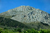 Corinth9826<br /> The monolithic steep rock, Acrocorinth, rises 1800 feet to a fortress bearing the same name. The easily defendable fortress also houses the Temple of Aphrodite.