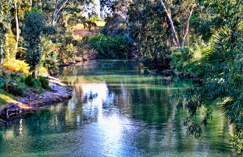 The tranquil Jordan River near the Yardenit Baptismal site.