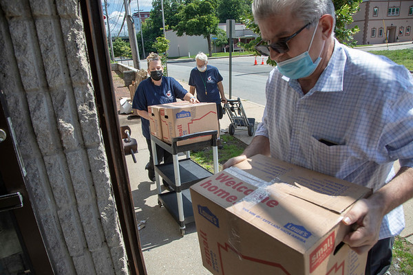 Karen McEvoy and Mike Koscuiszka (white hair), volunteers at Helping Hands Food Pantry in Teaneck, accept donations from Nick Lulani, owner of Amarone's Ristorante in Teaneck. 06/15/2021 Photo by Jeff Rhode/Holy Name Medical Center