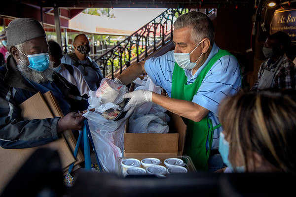 (L to R) Tony Ferreira volunteers at the Saint John's Soup Kitchen in Newark helping distribute meals to people in the community. 06/16/2021 Photo by Jeff Rhode/Holy Name Medical Center