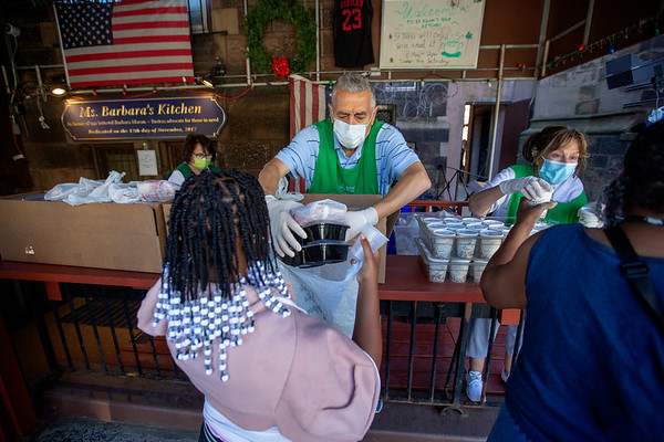 (L to R) Dorothy Zoppi, Tony Ferreira, and Gerri Swetz, volunteers at the Saint John's Soup Kitchen in Newark, help distribute meals to people in the community. 06/16/2021 Photo by Jeff Rhode/Holy Name Medical Center