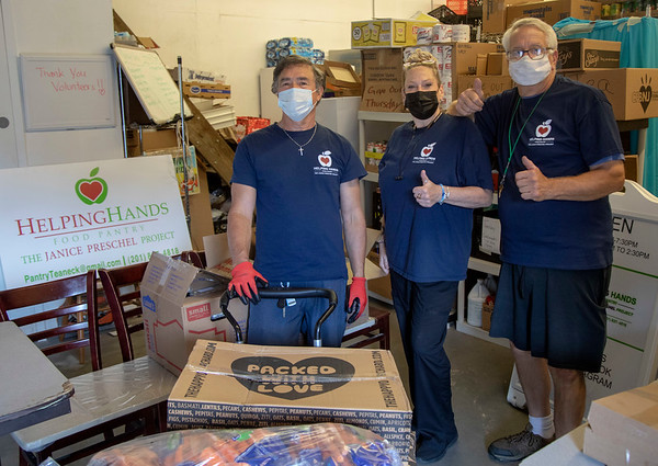 (L to R) Rene Rodriguez, Karen McEvoy and Mike Koscuiszka, volunteers at Helping Hands Food Pantry at the food pantry in Teaneck, NJ. 06/15/2021 Photo by Jeff Rhode/Holy Name Medical Center