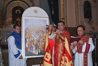 Fr. Vasken Kouzouian pours the Holy Muron (oil) for anointing.