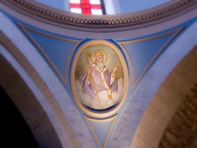 Saints are painted on each pillar.