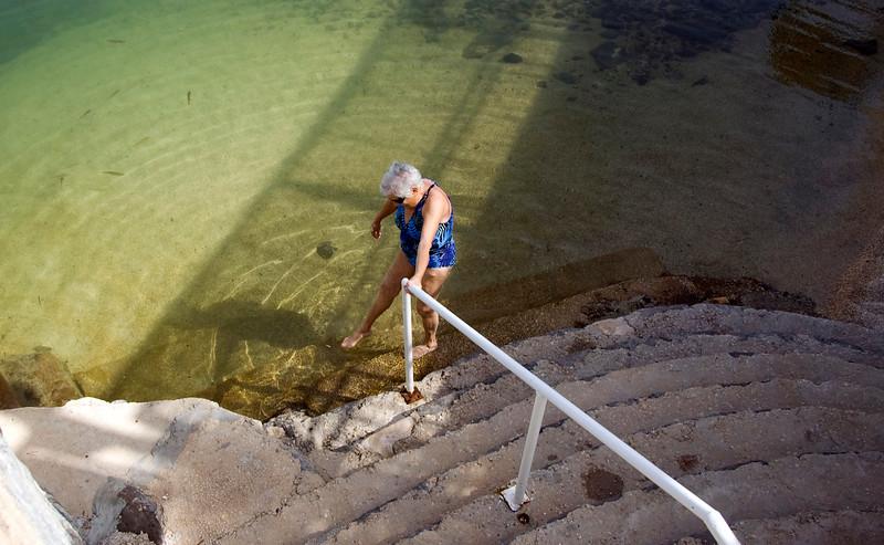 Dottie sticks her toe in the Sea of Galilee