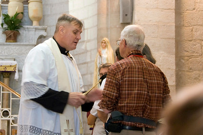 Father Rob blessing rings at the renewal of wedding vows.