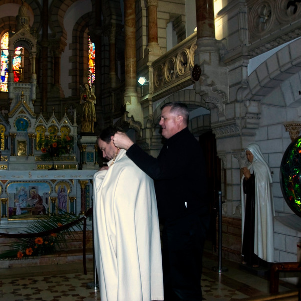 Father Rob passes the mantle to Joe