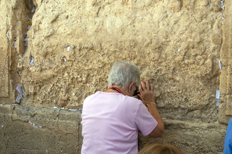 Dottie praying at the Wailing  Wall