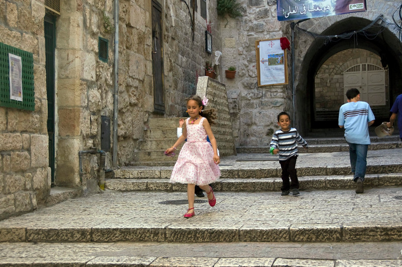 Children running in Jerusalem, enjoying their Sunday of rest.