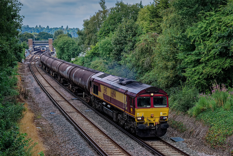66194 passes Haslemere station with 6Y32, the 08:24 Fawley - Holybourne empty tanks, <br /> on 29th August 2016.