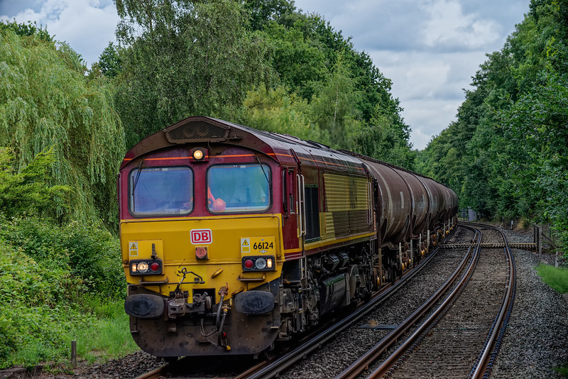 66124 passing Bentley station with 6Y32, the 08:24 Fawley - Holybourne empty tanks, on 10th August 2016.