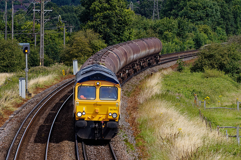 GB Railfreight ran a few trains to Holybourne. This is 66744 at Badshot Lea with 6O34, the 03:58 Parkstone Quay - Holybourne, on 30th July 2012.