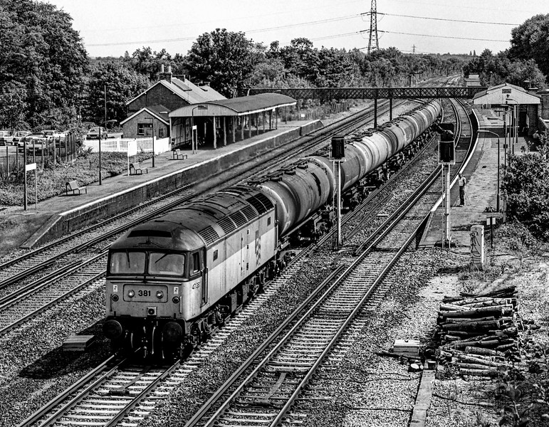 47381 passing Winchfield station with 6Y51, the 13:20 Holybourne - Eastleigh East Yard loaded tanks, on 11th August 1990.  Scanned negative.