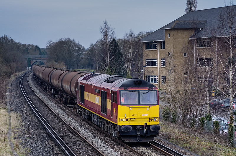 60071 passes the site of the former Peasmarsh Junction with 6Y32, the 08:24 Fawley - Holybourne empty tanks, on 6th March 2013.