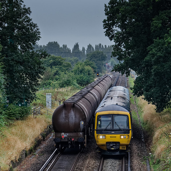66147 approaching Ash Level Crossing with 6Y32, the 08:24 Fawley - Holybourne empty tanks, on 5th September 2016. This was the finlal working from Fawley to Holybourne, where the tanks were going for storage. 166208 was working the 10:34 Reading - Gatwick.
