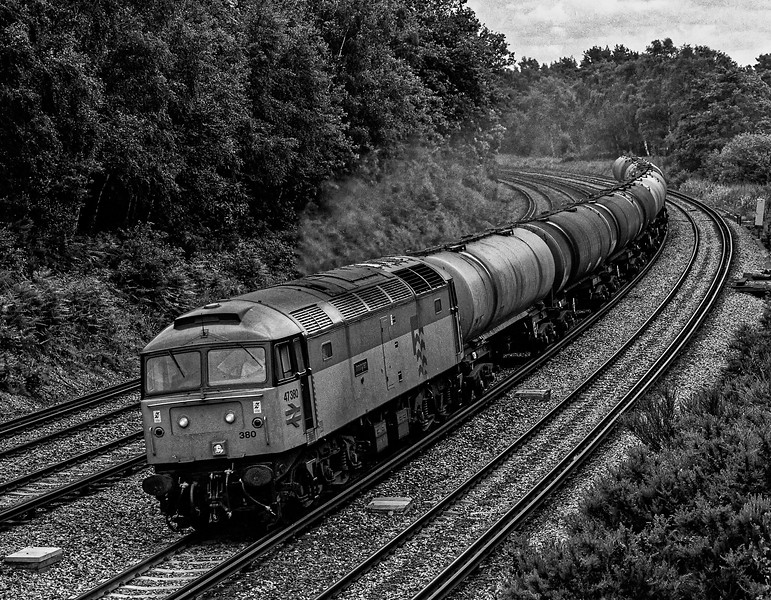 47380 rounds the curve at Pirbright with 6Y51, the 13:20 Holybourne - Eastleigh East Yard loaded tanks, on 23rd June 1990. Scanned negative.