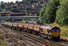 Viewed from Yorkies Bridge, 66030 passes Guildford with 6Y32, the 08:25 Fawley - Holbourne empty tanks, on 6th August 2014.