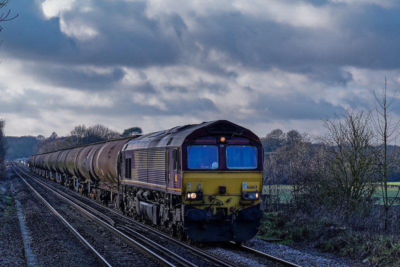 66167 aproaching Wanborough station with 6Y34, the 13:54 Holybourne - Long Marston, on 23rd January 2019. The tanks were going for cleaning and scrapping.