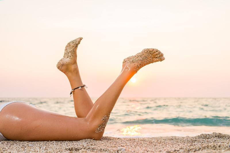 Woman in white bikini on the beach