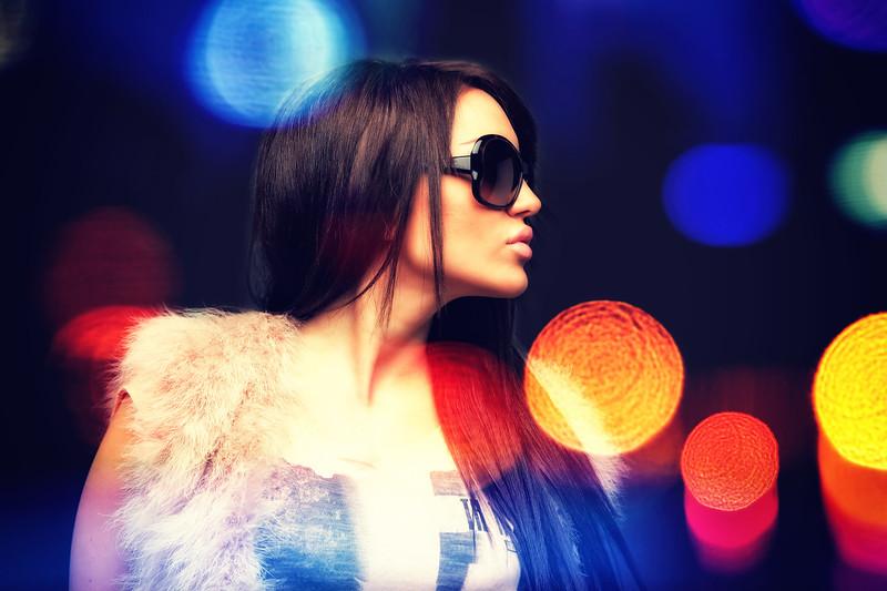 Woman portrait with night city street lights