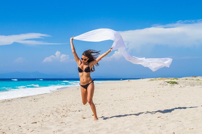 beautiful woman in bikini with pareo on the beach