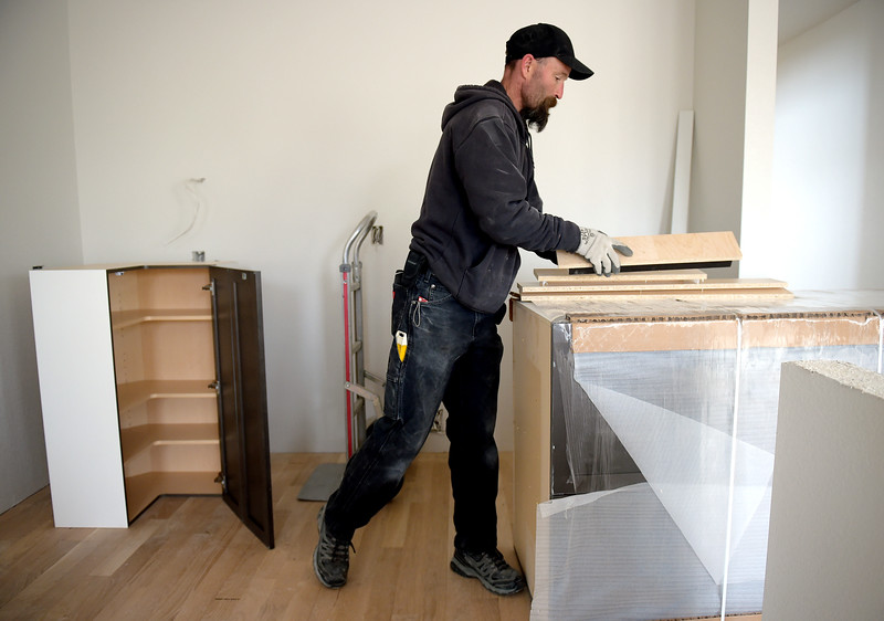 Brian Bradford, Of Boulder Cabinet Solutions, Prepares To Install Cabinets  In A Home Under