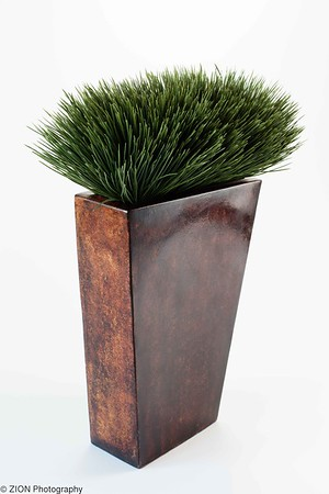 A decorative vase with grass