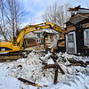 """KRISTOPHER RADDER — BRATTLEBORO REFORMER<br /> John Allen, a former select board member, bought a neighboring property at 203 Fairview Street, in Brattleboro, and hired Bellco Excavation to do the demolition work on the land. """"We had a neighbor here for 17, 18, years, and he walked away from the property about five years ago,"""" said Allen.  Allen, a builder, said he plans on rebuilding the house 20 feet back from its current location."""