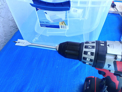 "Background Information:  A 3/4"" spade bit works well to drill holes in the plastic container."