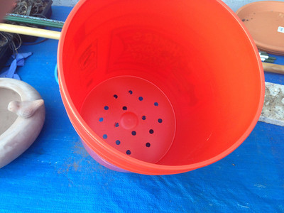 Step 1: Drill holes at the bottom of the bucket.  There is no specific requirement for the number or diameter of the holes.