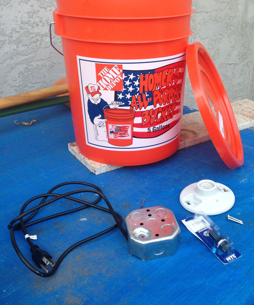 Materials required: Home Depot bucket and cover, electric cord, metal junction box, ceramic CFL holder, 1 amp fuse and holder, and 14W CFL lamp (not shown).